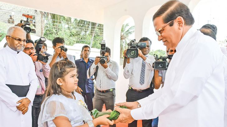 President Maithripala Sirisena being welcomed by a child at the State Christmas Festival held at the HIndu Cultural Centre, Trincomalee. Picture courtesy President's Media Division