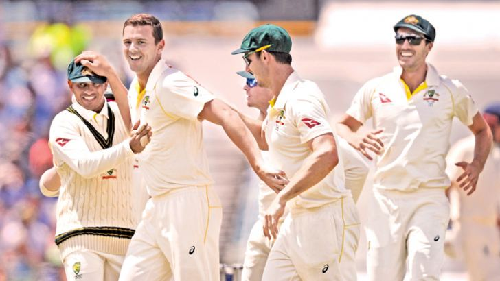Australian bowler Josh Hazlewood (2nd L) celebrates with teammates after dismissing England's Mark Stoneman on day four of the third Ashes cricket Test match between Australia and England in Perth on December 17.  AFP
