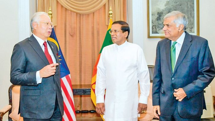 President Maithripala Sirisena hosted visiting Malaysian Prime Minister Najib Razak to lunch at the President's House in Colombo Fort yesterday. Prime Minister Razak who is on a three day official visit signed several bilateral co-operation agreements with Sri Lanka, before the luncheon meeting. Prime Minister Ranil Wickremesinghe and several ministers were also present on the occasion. Picture by Sudath Silva