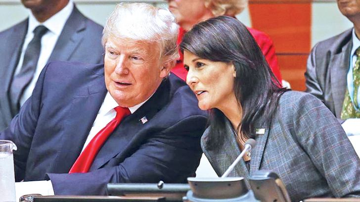 US President Donald Trump speaks with US Ambassador to the United Nations Nikki Haley before a meeting during the United Nations General Assembly at UN headquarters on Monday.