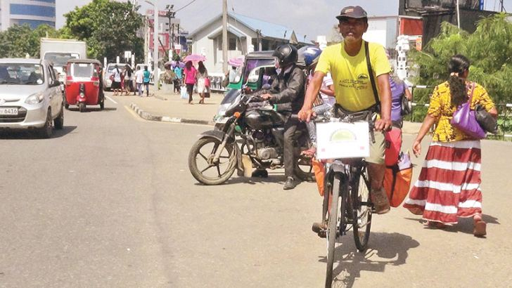 Tapan Kumar Das riding through the Matara town