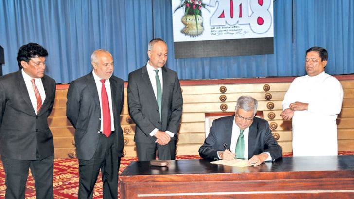 Prime Minister Ranil Wickremesinghe signing the proposed criteria for media