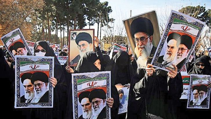 Pro-government demonstrators hold posters of Iran's supreme leader, Ayatollah Ali Khamenei (L) and Iran's founder of Islamic Republic, Ayatollah Ruhollah Khomeini during a march on Thursday.- AFP