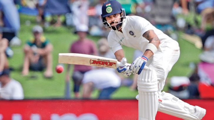 India's captain Virat Kohli plays a shot during the second day of the second Test cricket match between South Africa and India at Supersport cricket ground on Sunday. AFP