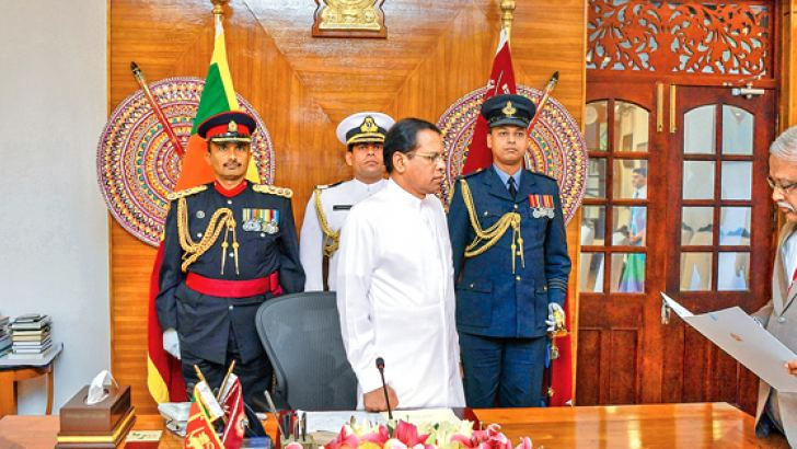 L. T. B. Dehideniya took his oaths as a Justice of the Supreme Court before President Maithripala Sirisena at the Presidents official residence, yesterday morning.