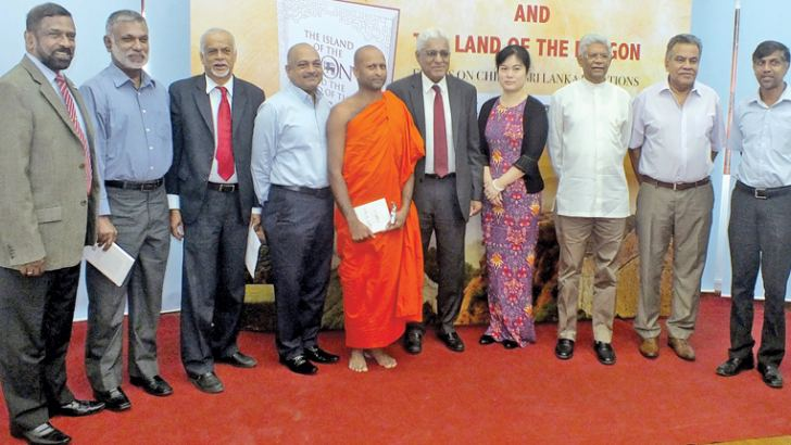 Ven Dr. Nedalagamuwe Dhammadinna Thera, Pang Chunxue, Charge d'Affaires of the Chinese Embassy in Sri Lanka with leading daily English newspaper editors and Central Bank Governor Dr. Indrajit Coomaraswamy, Ambassador Bernard Goonatilleke, Admiral Dr. Jayanath Colombage and Luxman Siriwardena, Executive Director, Pathfinder Foundation/Director, China-Sri Lanka Cooperation Studies Centre, at the event