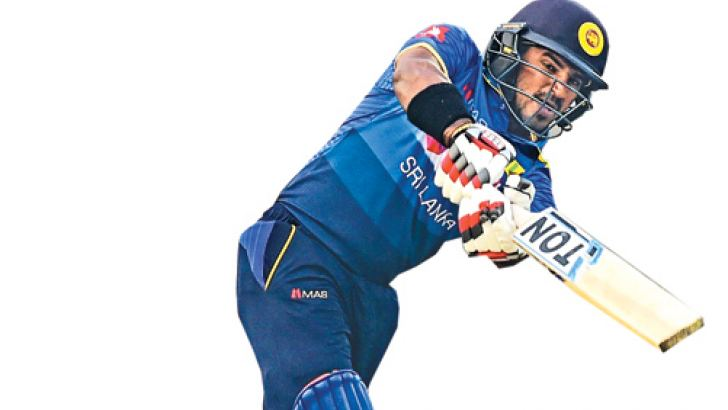 Kusal Perera plays a shot during his knock of 80 in the tri-nation match against Bangladesh at Dhaka on Wednesday. AFP