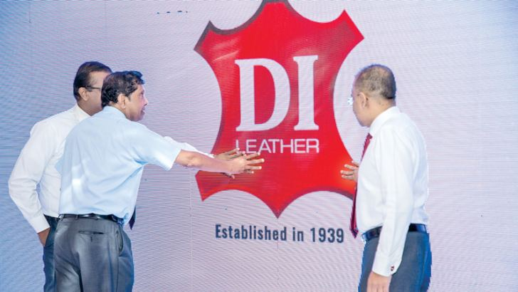 Ceylon Leather Products  Chairman Neville C. Peiris,  Sajeewa Ranasinghe, Chief Operating Officer, Ceylon Leather Products and Murali Prakash, Director Ceylon Leather Products ,  Chief Executive Officer  and Managing  Director Taprobane Holdings and Lanka Century Investments unveiling the new logo.