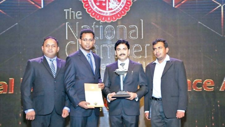 Associated Battery Manufacturers (Ceylon) Limited Director, CEO M. Ramachandran with the Runner Up award in the manufacturing-engineering sector category at the National Business Excellence Awards 2017.