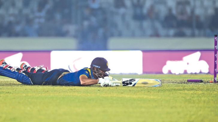 Sri Lanka's acting captain Dinesh Chandimal is run out for 28 in their tri-series match against Bangladesh at Dhaka on Friday. AFP