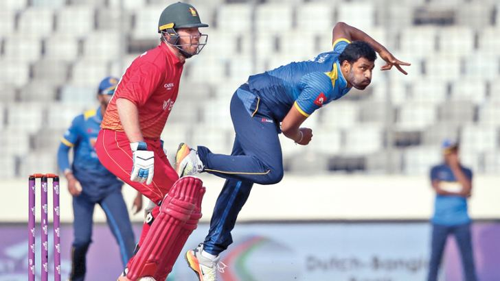 Sri Lanka all-rounder Thisara Perera delivers a ball during the tri-series match against Zimbabwe at Dhaka on Sunday. Perera captured four wickets and also scored the winning runs a hit for six to take the Man of the Match award. - AFP