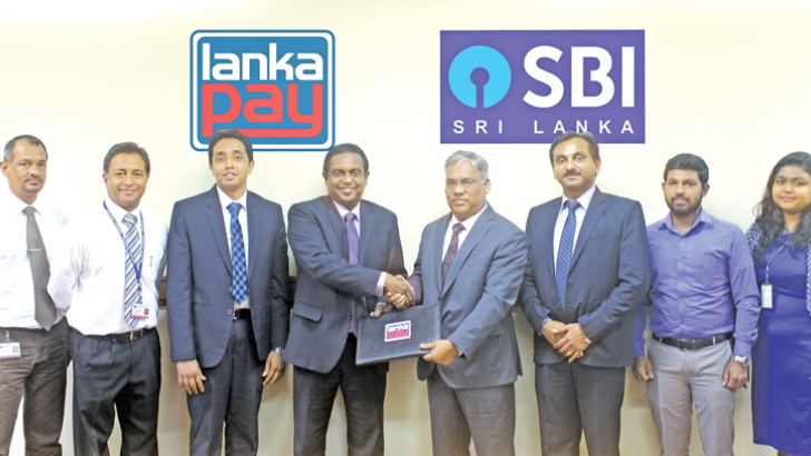 Hemanthe Samaliarachchi, Head of Certification and Integration of LankaClear; Isuru Jayaweera, Head of External Services of LankaClear; Dinuka Perera, DGM - IT & Operations of LankaClear; Channa de Silva, GM/CEO of LankaClear; Rajeev Ratna Srivastava, Country Head, State Bank of India; Hemant Jaiswal, SVP and Branch Head, Colombo; Vinoth and Taniya, IT team of SBI Sri Lanka.