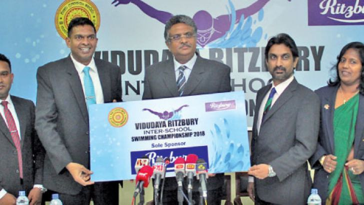 The sponsorship cheque for the swimming meet is being handed over by Marketing Manager of CBL, Nilupul de Silva (2nd from left) to Vice Chancellor of the University Professor Sampath Amaratunga. (From left) Assistant Brand Manager of CBL Aruna Liyanapathirana, Chairman of Sports Advisory Board Professor Pradeep Jayaweera and Director of Physical Education Nishanthi Vidanage are also in the picture. Picture by Ruwan de Silva