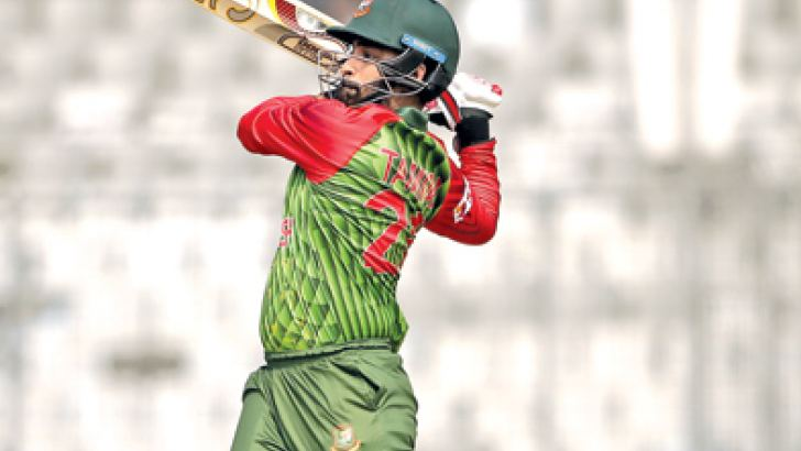 Bangladesh opener Tamim Iqbal plays a shot during the tri-series match against Zimbabwe at Dhaka on Tuesday. AFP