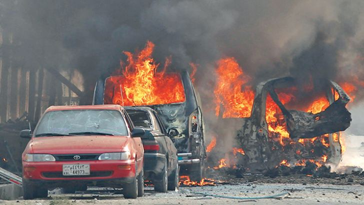 Vehicles are seen on fire after a blast in Jalalabad, Afghanistan yesterday.
