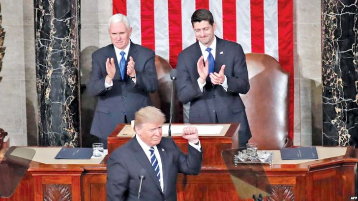 US President Donald Trump makes his first address to joint session of Congress flanked by US Vice President Mike Pence (L) and Speaker of the House Paul Ryan.