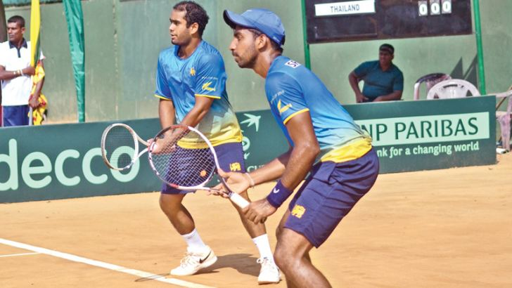 Sharmal Dissanayaka (right) and Yasitha de Silva in action during the doubles match