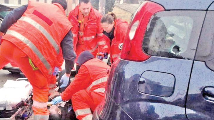 Paramedics attend to the needs of one of the injured in the Macerata drive-by shooting.