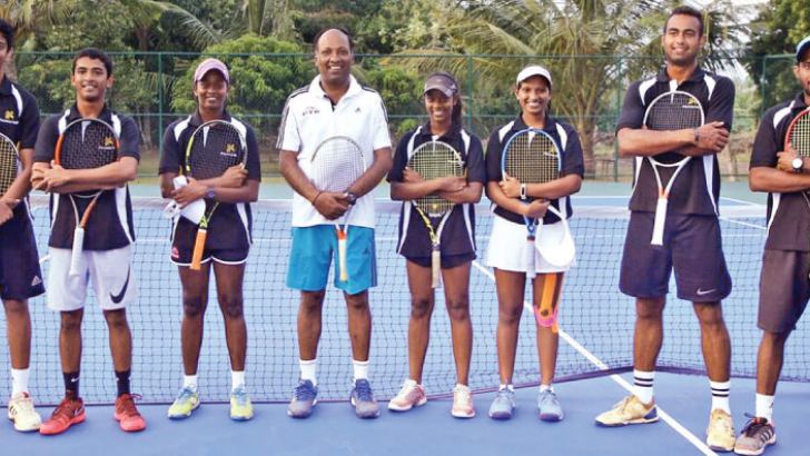 The players who played the exhibition match at the newly opened Pegasus Reef tennis courts with the head coach G. Subramaniam.