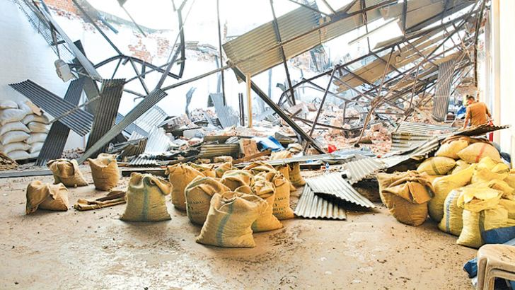 The collapsed building of Adam Exports.  Pictures by Sarath Peiris