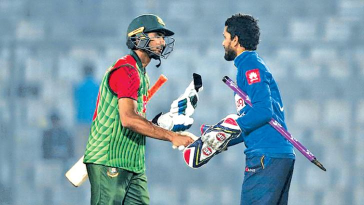 Rival captains at today's first T20 international Mahmudullah (Bangladesh) and Dinesh Chandimal (Sri Lanka).
