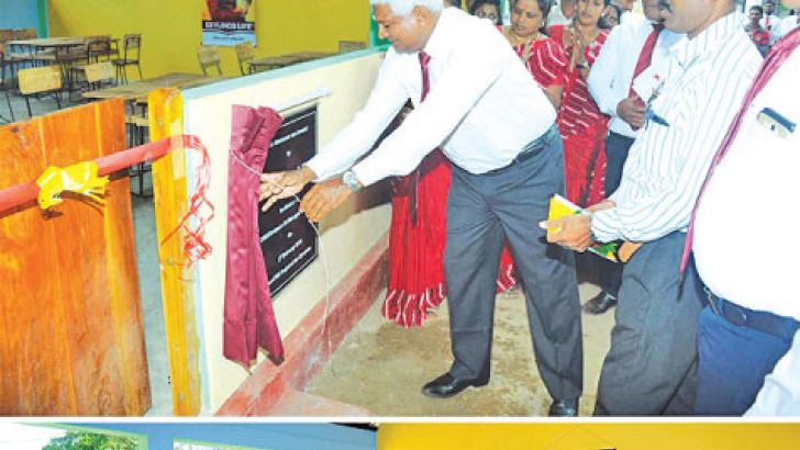 Ceylinco Life Managing Director and CEO,  R. Renganathan unveils the plaque at the presentation to the Sampur Sri Murugan Vidyalayam in Mutur, Trincomalee.