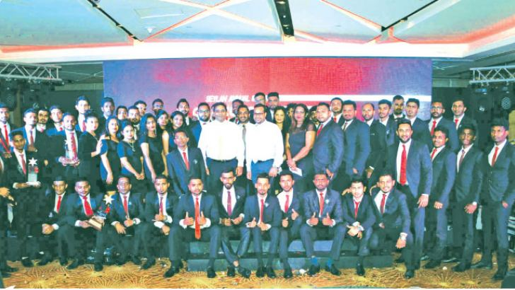 Seylan Bank's Director and  CEO –Kapila Ariyaratne, Deputy General Manager Retail Banking –Tilan Wijeyesekera and Head of Marketing and Sales  Gamika De Silva with the winning employees.