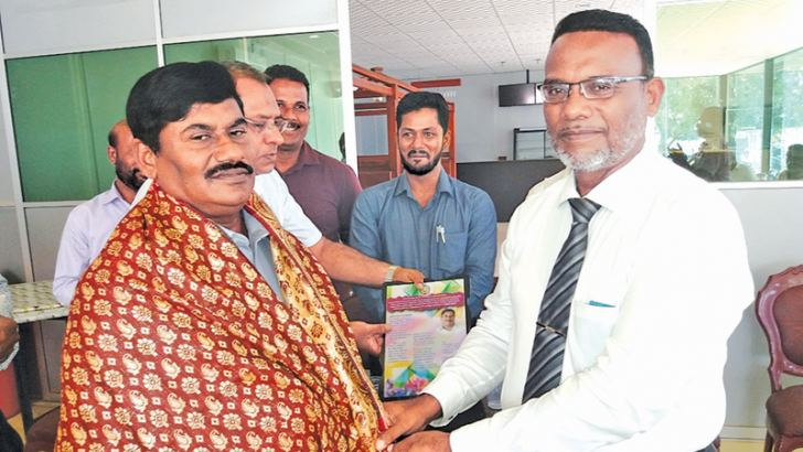Former Akkaraipattu Zonal Education Office Teacher Centre Manager M. Thangavel being greeted with a golden shawl. Picture by I. L. M. RIZAN, Addalaichenai Central Corr.