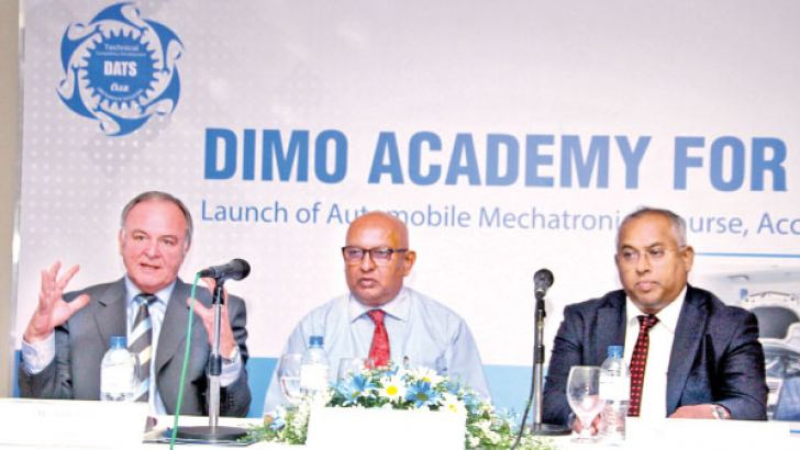 General Manager Technical Competency Development – DIMO Automobile Training School (DATS), Jobst Ferber, Chairman & Managing Director, DIMO Ranjith  Pandithage and Group CEO, DIMO Gahanath Pandithage. Picture by Sulochana Gamage
