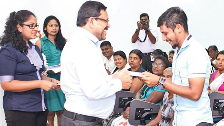 Sirio CEO Felix A. Fernando presenting a cheque to a villager affected by the recent inclement weather.