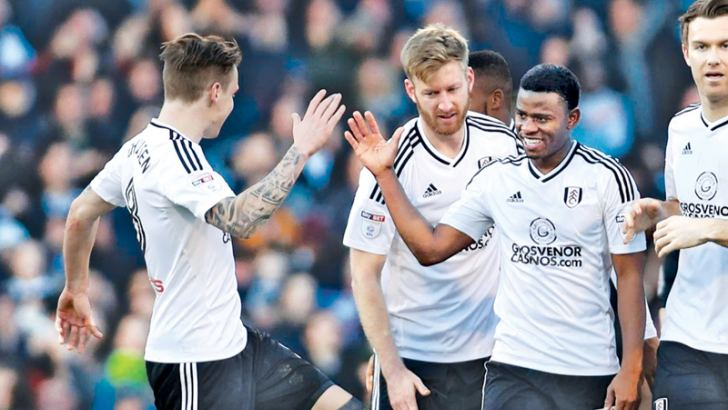 Fulham's Floyd Ayite celebrates with team mates after scoring their second goal against Aston Villa