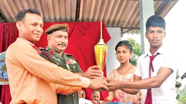The skipper of Runner-up Diesels House receiving the trophy from Sammanthurai Educational Zone Deputy Education Director M.H.M. Jabir