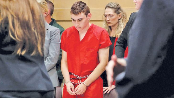 Nikolas Cruz, facing 17 charges of premeditated murder in the mass shooting at Marjory Stoneman Douglas High School in Parkland, appears in court for a status hearing in Fort Lauderdale, Florida, on Monday.
