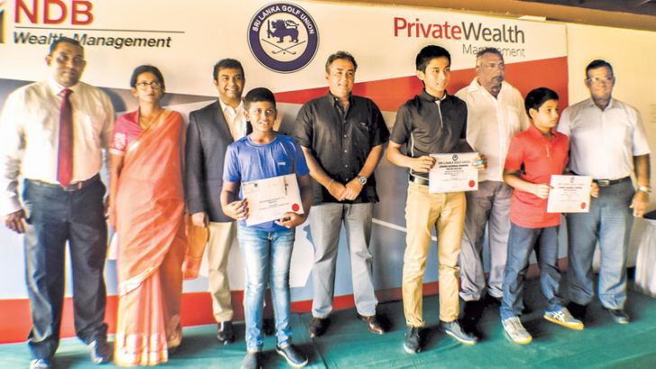 The top ranked players with officials. Back row from left - COO of NDB Wealth - Ruwan Perera, Chairperson of Junior Sub Committee – SLGU - Niloo Jayatilake, CEO of NDB Wealth Prabodha Samarasekera, Chairman of National Selectors - Navin de Silva, National Selector - Sunil Jayakody and president - SLGU - Priath Fernando. Front row from left - Shanal Binushka,Vinod Weerasinghe, Reshan Algama. Absent -Taniya Balasuriya and S. Dhuwarshan. Picture by Hurbert Perera