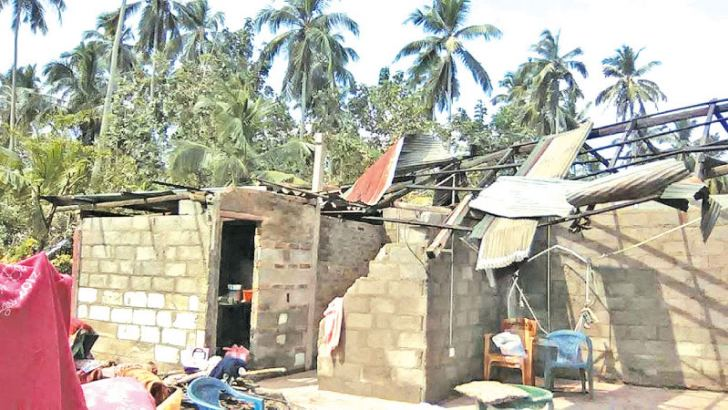 Houses damaged as a result of the Tornado that struck Badalgama.