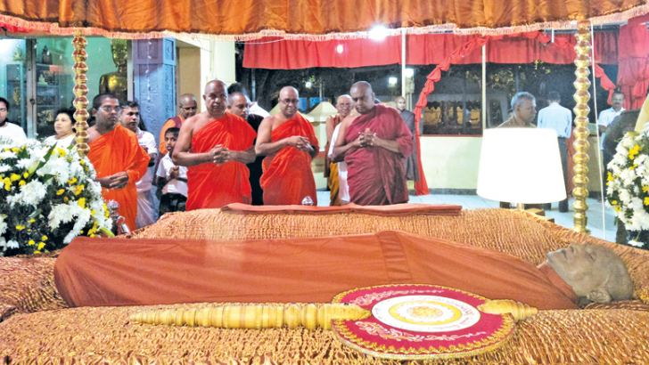 Members of the Maha Sangha pay their respects to the late Most Ven. Girambe Ananda Anunayake Thera, at the Sri Sarananda Maha Pirivena Viharaya in Anuradhapura. Picture by Anuradhapura Central Group Corr.