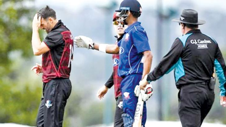 Auckland batsman Jeet Raval checks on the condition of Canterbury bowler Andrew Ellis after he had hit him on the head and the ball went for six