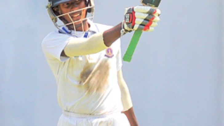 Thurstan century maker Jayavihan Mahavithana plays a shot during his innings of 125 not out on his debut in the 55th Battle of the Brothers cricket match against Isipathana at the SSC grounds yesterday. (Pic by Susantha Wijegunasekera)