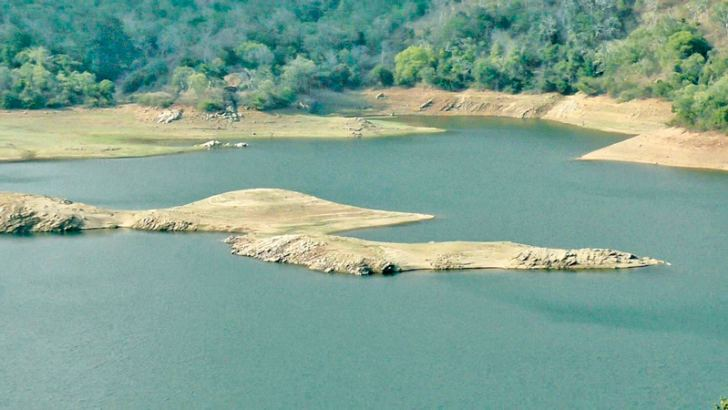 The receeded water level at Randenigala.