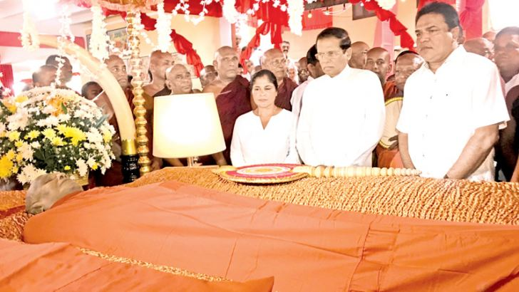 The President paying homage to the remains of the  Most Ven. Girambe Ananda Anunayake Thera.
