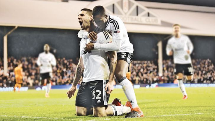 Fulham's Aleksandar Mitrovic celebrates scoring their second goal with Ryan Sessegnon against Wolves