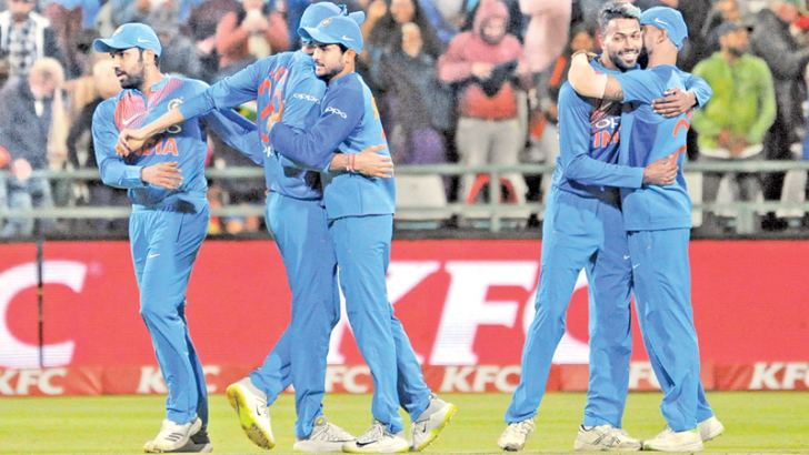India's players celebrate after winning the third T20 cricket match between India and South Africa at the Newlands Cricket Ground on February 24, 2018 in Cape Town.  AFP