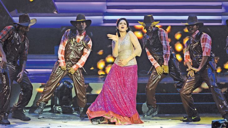 (FILES) This file photo taken on July 6, 2013 shows actress Sridevi Kapoor (C) performing at the 14th International Indian Film Academy (IIFA) Awards ceremony at the Venetian hotel in Macau. - AFP